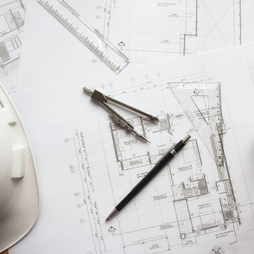 Image of engineering objects on workplace top view.Construction concept. Engineering tools.Vintage tone retro filter effect,soft focus(selective focus)